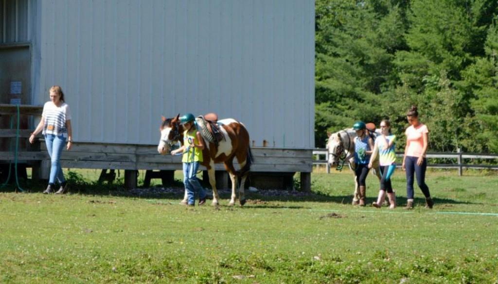 Campers enjoying horseback riding
