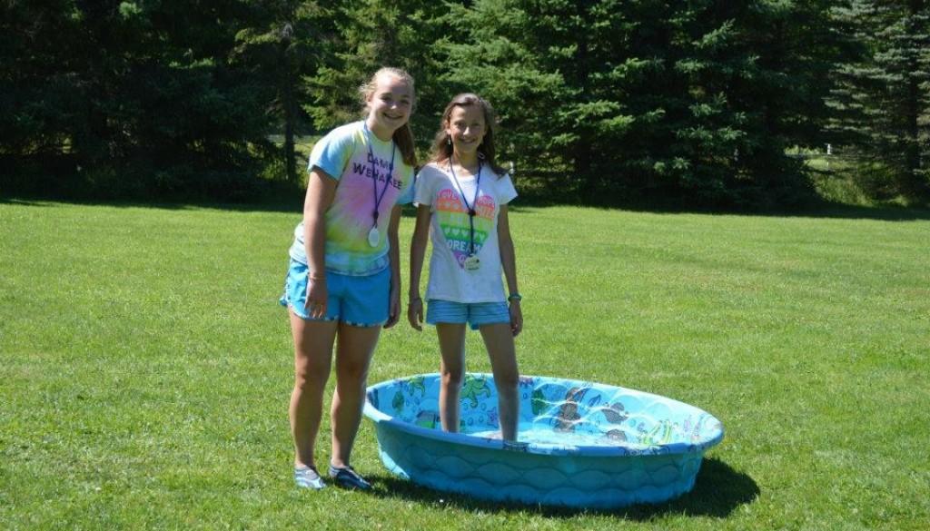 Campers smiling in the kiddie pool