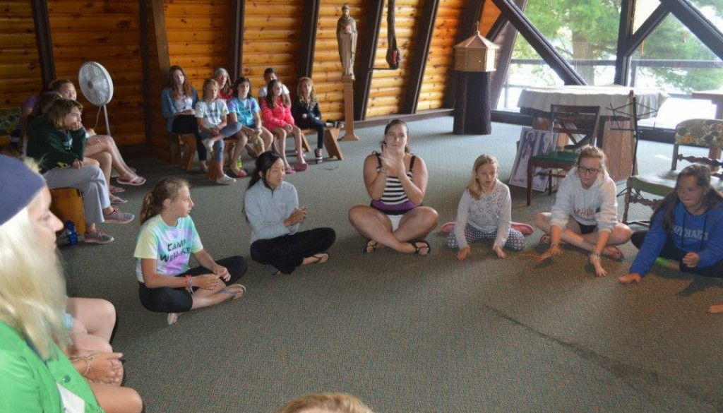 Campers playing hand clapping games