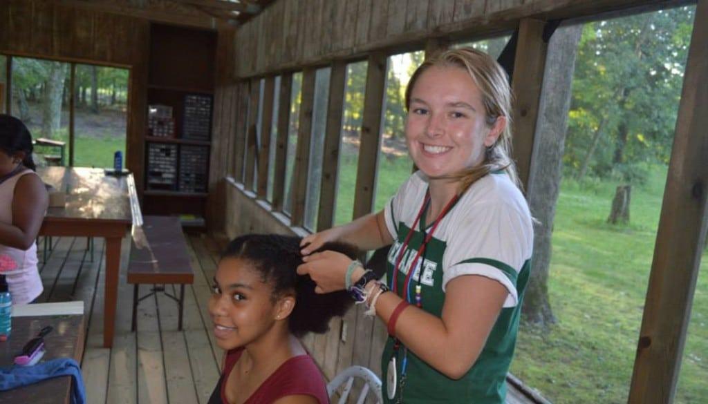 Campers braiding hair