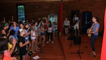 singing at camp with everyone