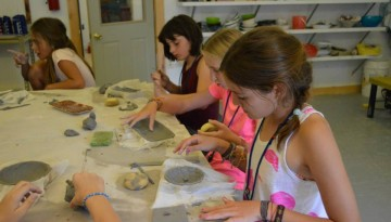 Campers playing with clay