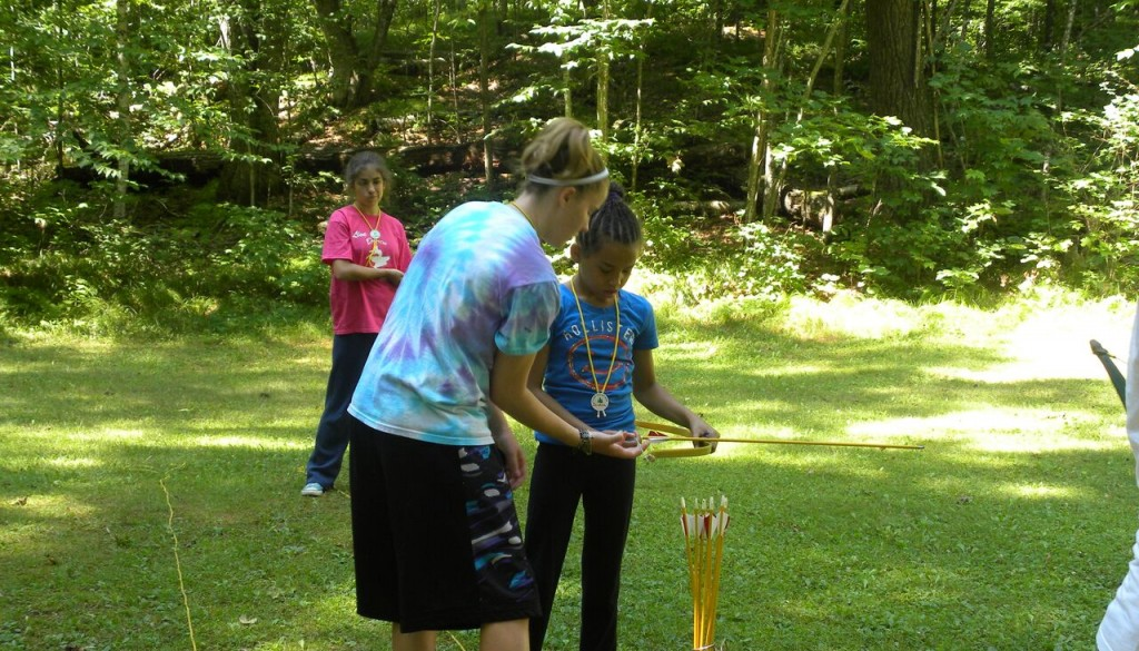 Counselors teaching campers the art of archery at Camp WeHaKee