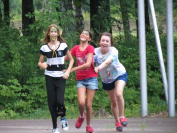 Excited campers running to join their new WeHaKee friends.
