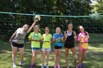 WeHaKee campers playing volleyball.