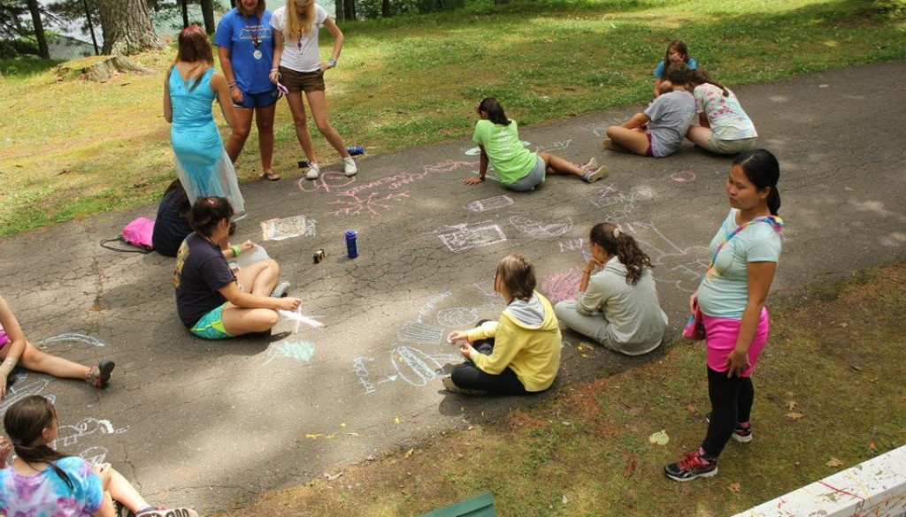 Campers playing with chalk