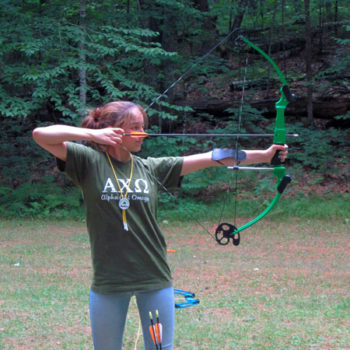 Camper practicing archery at WeHaKee Camp for Girls
