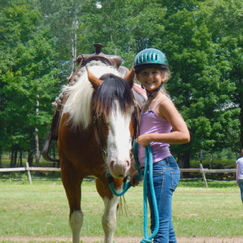 Happy camper and her horse at WeHaKee Camp for Girls