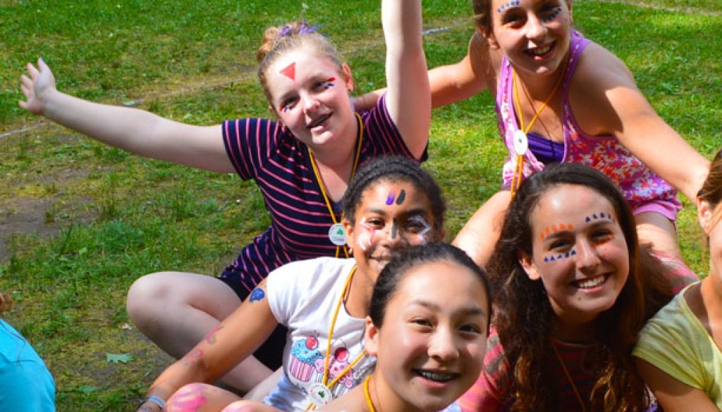Happy campers with painted faces at WeHaKee Camp for Girls