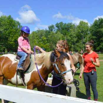 Campers getting ready to go horseback riding.