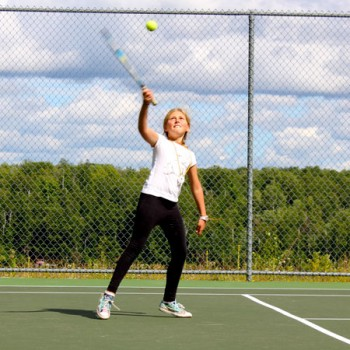 Camper playing tennis