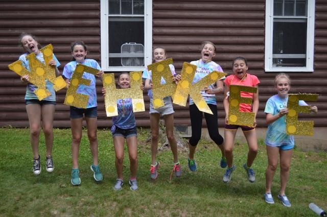 WeHaKee campers holding letters