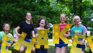 Campers at Girls Camp jumping for joy to be at WeHaKee Camp for Girls