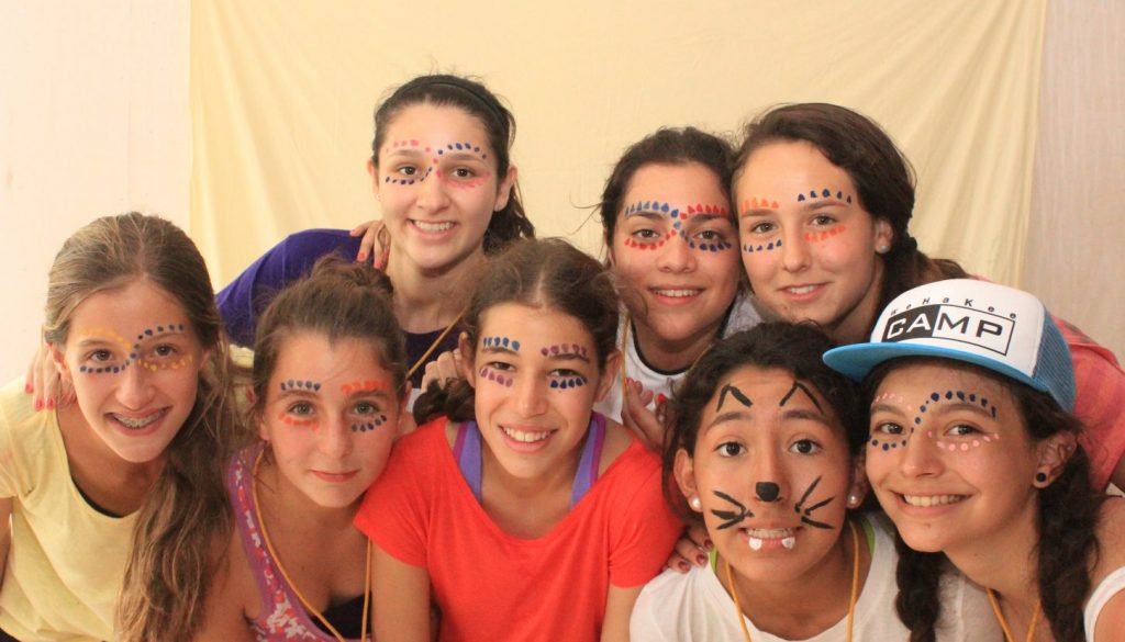 Campers with face paint at WeHaKee Camp for Girls.
