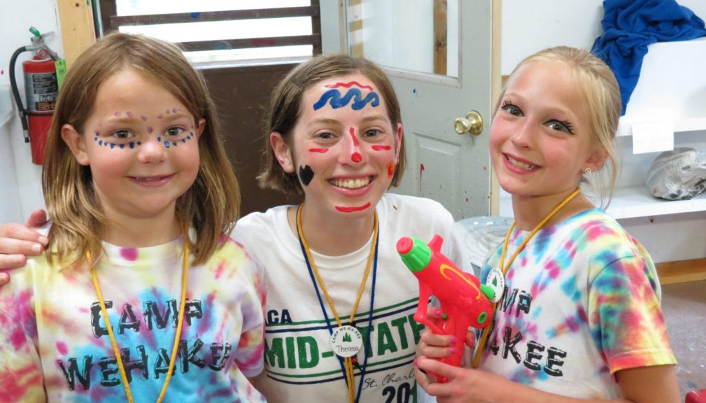Campers and staff with face paints at WeHaKee Camp for Girls.