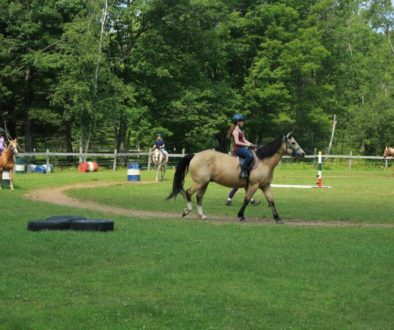 Summer staff horseback riding at WeHaKee Camp for Girls.