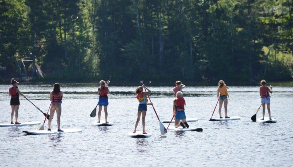 WeHaKee Camp for Girls paddle boarding on Lake Hunter.