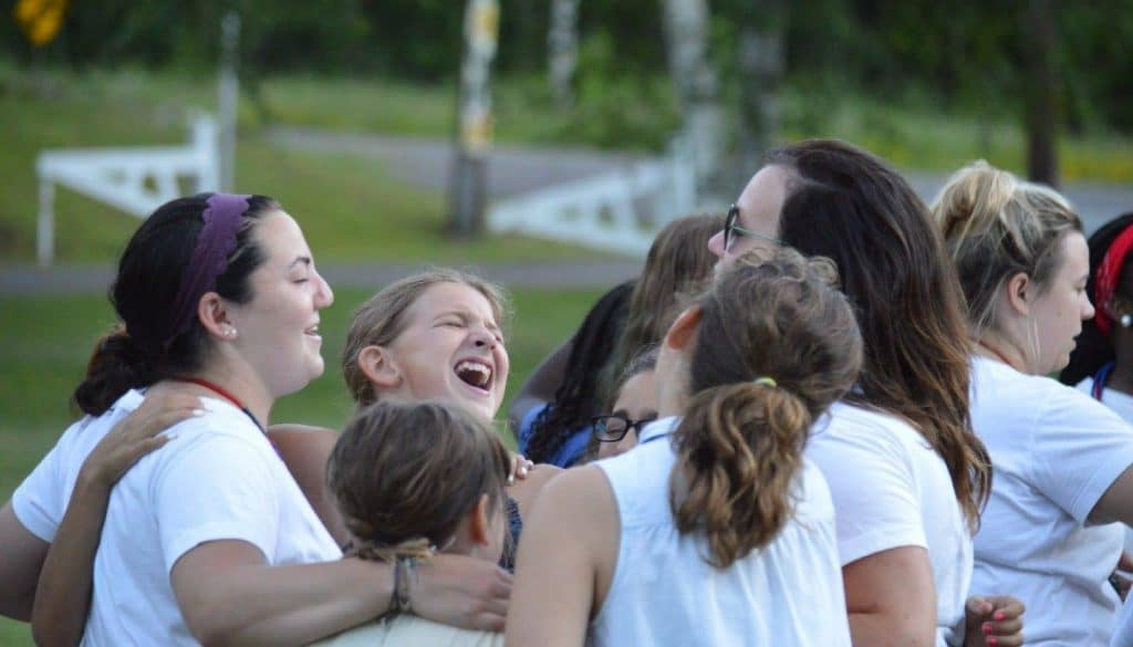 Staff and campers at WeHaKee Camp for Girls giving a big group hug.