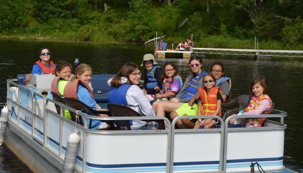 WeHaKee Camp for Girls campers on a pontoon boat.