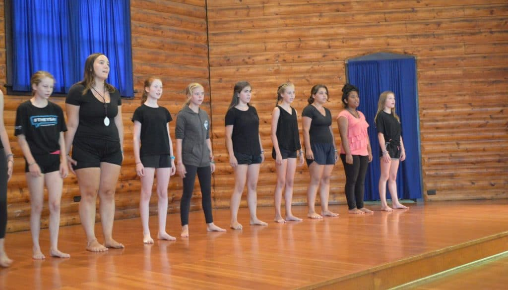 WeHaKee Camp for Girls campers on the cabin stage for a performance.