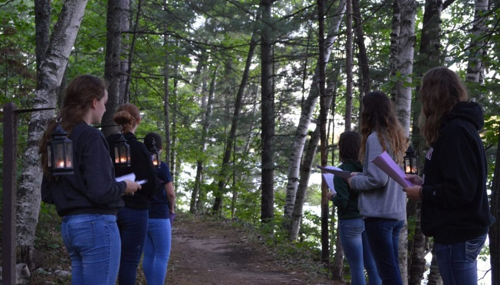 Campers waiting on a trail at WeHaKee Camp for Girls.