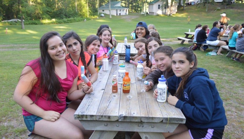 WeHaKee Camp for Girls campers enjoying popsicles.