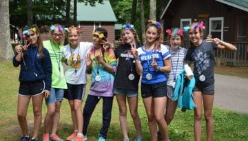 WeHaKee Camp for Girls campers wearing flower crowns.