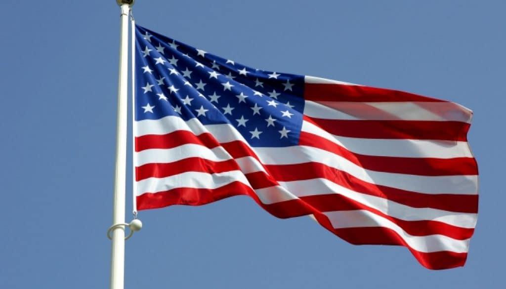 The American flag on a flag pole.