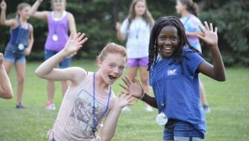 Campers waving at WeHaKee Camp for Girls.