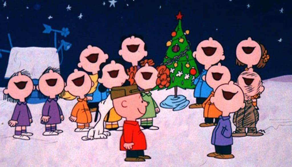 Charlie Brown singing around the Christmas tree.