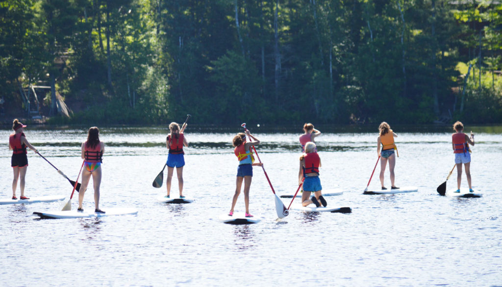 Stand-Up-Paddle Group on Hunter Lake at WeHaKee Camp for Girls