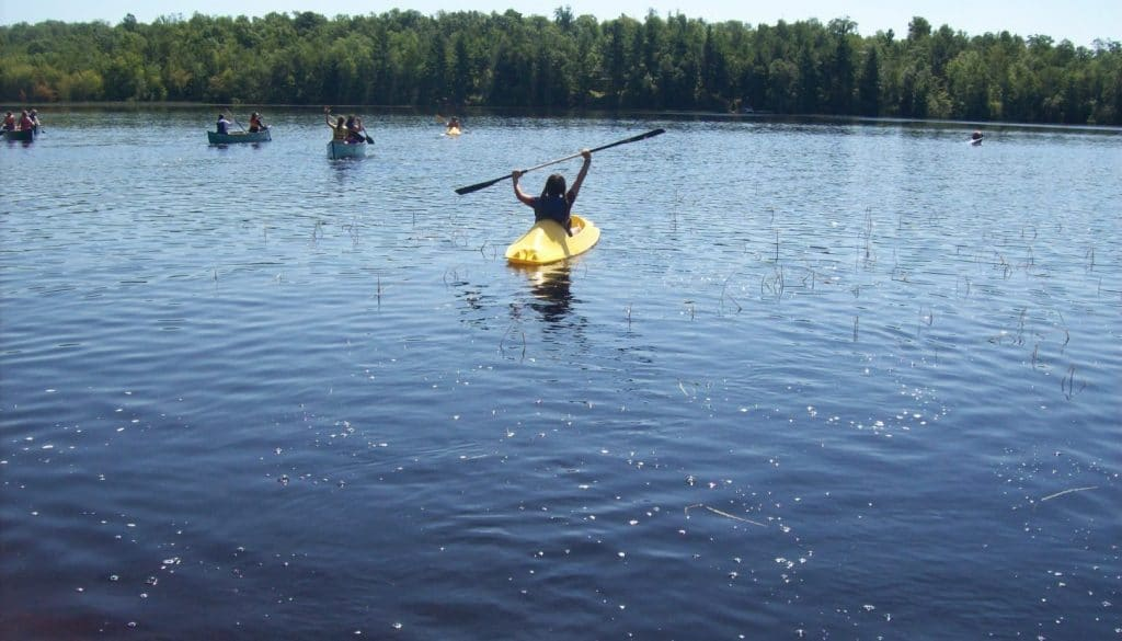 Campers kayaking and canoeing on Hunter Lake.