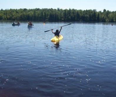 Campers kayaking and canoeing on Hunter Lake.