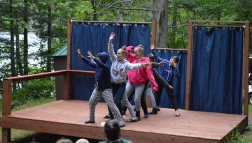 WeHaKee Camp for Girls campers and staff putting on a show for other campers.