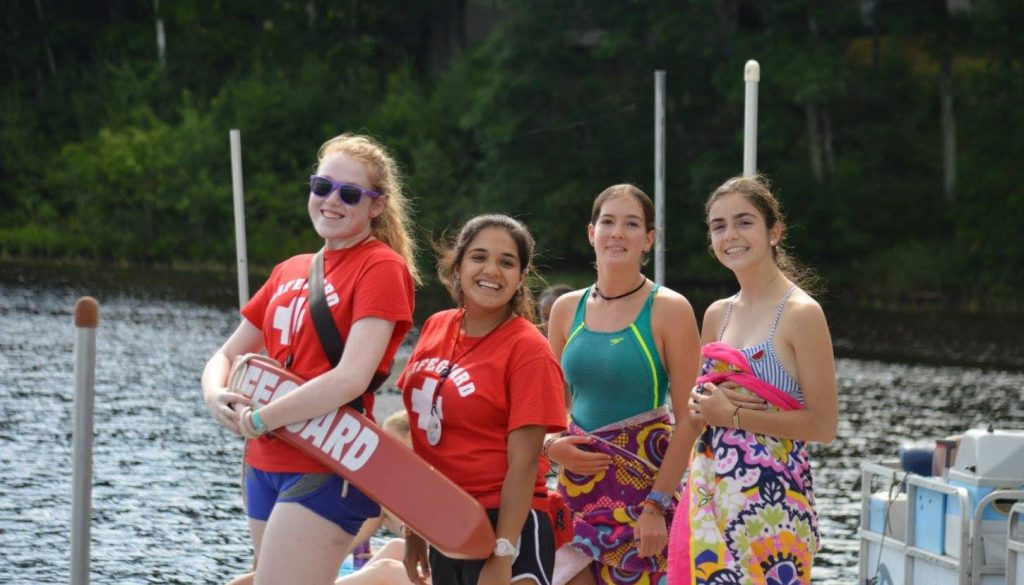 WeHaKee Camp for Girls lifeguards and campers on the dock.