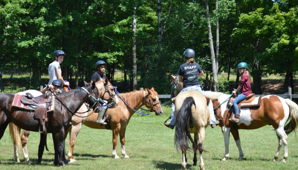 WeHaKee Camp for Girls staff and campers horseback riding.
