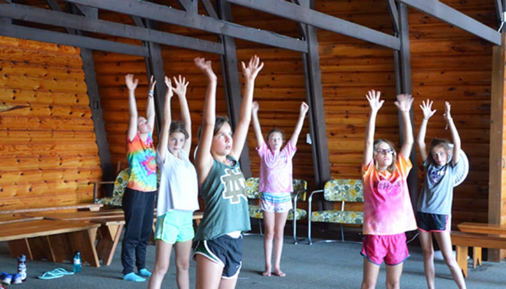 WeHaKee Camp for Girls Campers stretching.