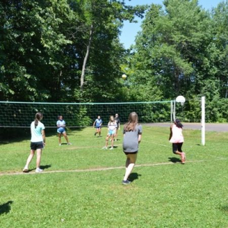 Girls at camp playing volleyball