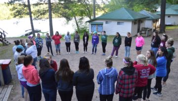 WeHaKee Camp for Girls Campers in a circle playing a game.
