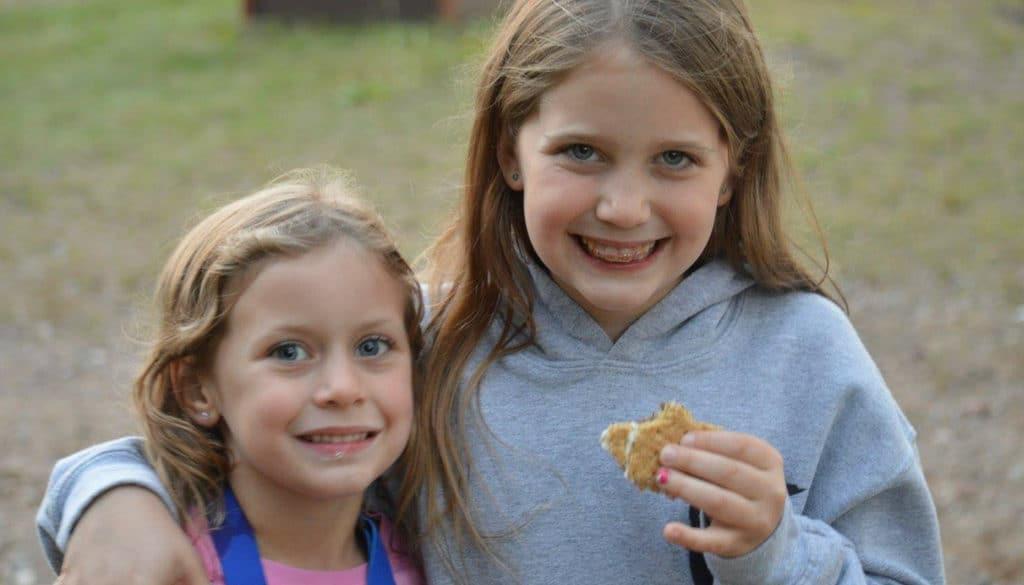 WeHaKee Camp for Girls campers enjoying smores.