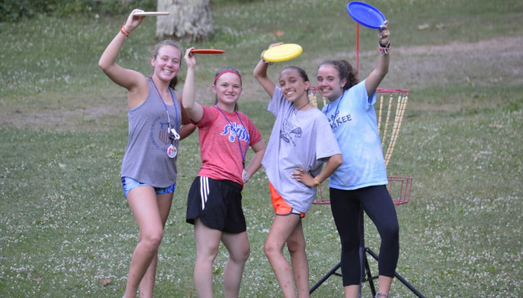 WeHakee Camp for Girls campers playing frisbee golf.