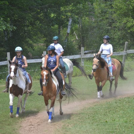 Horseback riding at WeHaKee Camp for Girls.