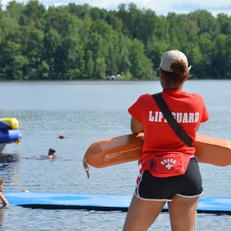 WeHakee Camp for Girls lifeguard staff watching over campers swimming Hunter Lake.