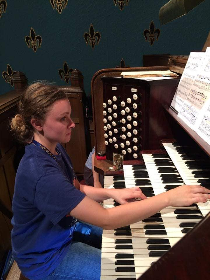 WeHaKee Camp for Girls Staff: Katherine playing on the piano.