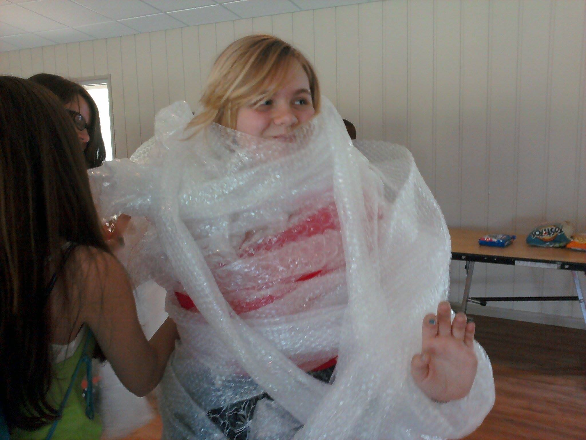 WeHaKee Camp for Girls Staff: Sarah wrapped in bubblewrap.