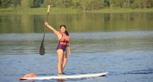 WeHaKee Camp For Girls camper paddle boarding on hunter lake.